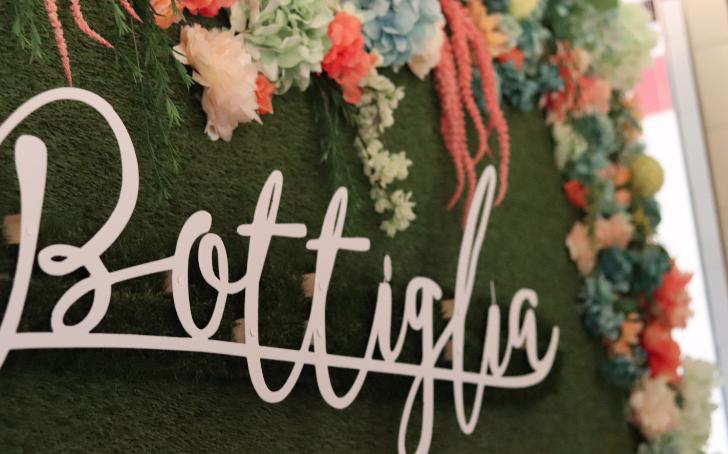Henderson's Bottiglia Cucina & Enoteca Flower Wall
