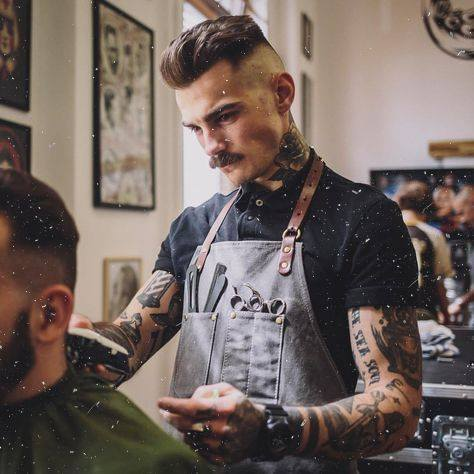 A Mustachioed Barber Cuts Hair at The Barbershop Cuts & Cocktails on the Las Vegas Strip