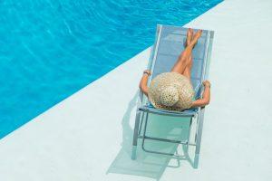 Lady on Chaise - Retreat Pool & Cabanas