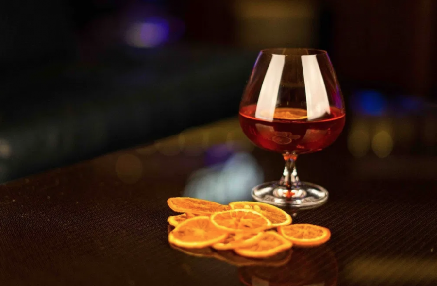 Take a Walk on the Dark Side with the Mysterious Blood Moon Cocktail at Clique Bar & Lounge
